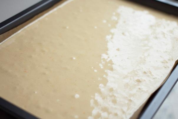 sponge cake batter on baking sheet